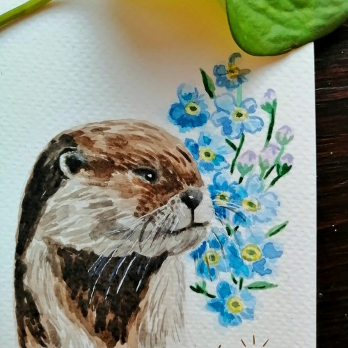 Otter with forget-me-not flowers